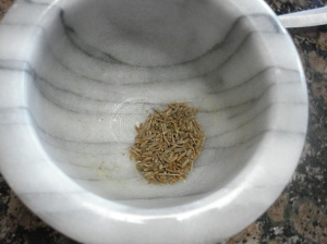 Picture of cumin in mortar
